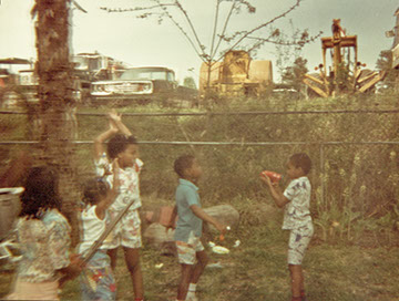 This photo given to Brian Brijbag shows young children playing in a backyard near the public works site